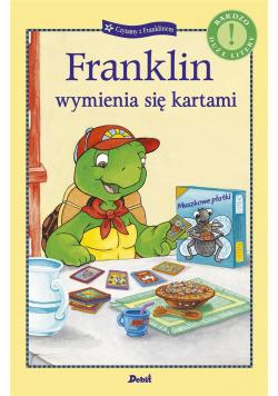 Franklin wymienia się kartami